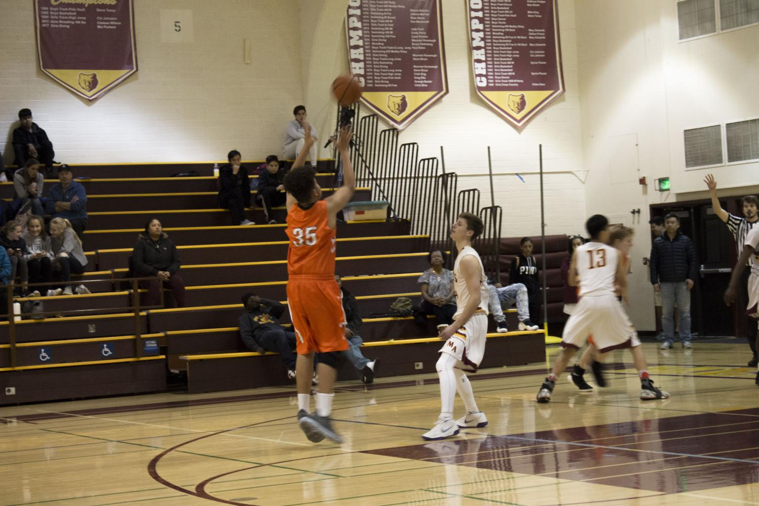 De'Andre Brown, Woodside Center, jumping to catch the baseline pass.