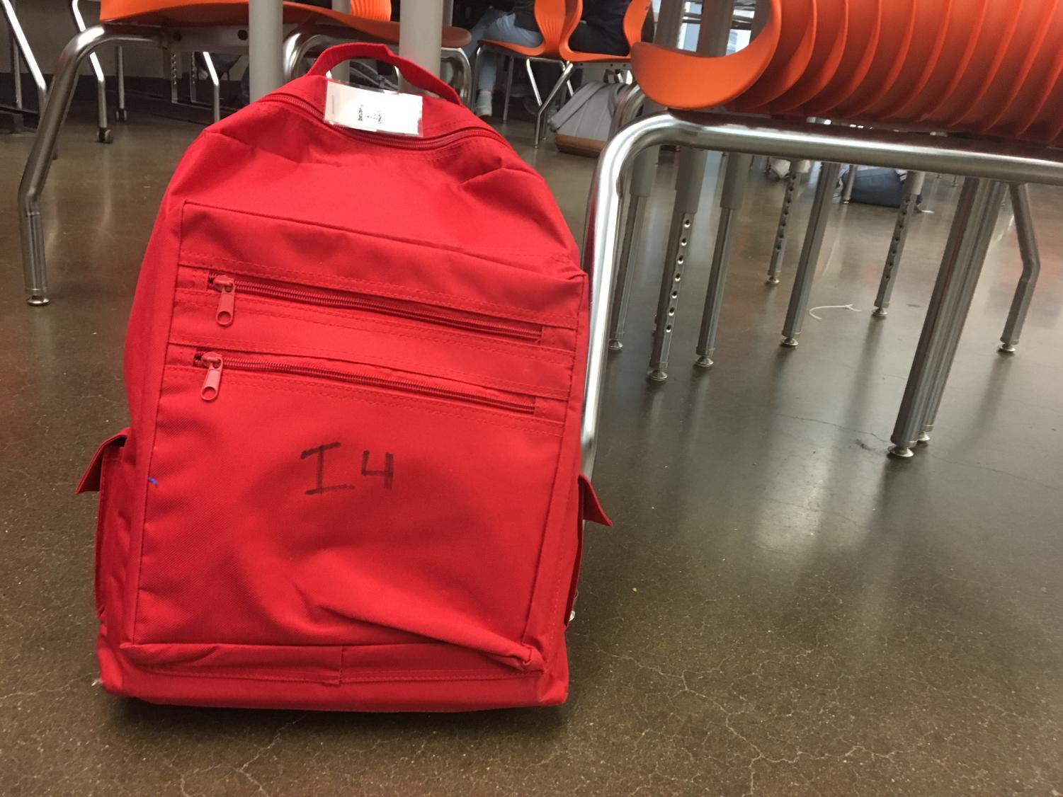 An emergency backpack sits in I-4. In case of an emergency, the backpack carries supplies for the class.