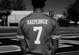 Tommy Williams in Kaepernick's 49ers jersey.