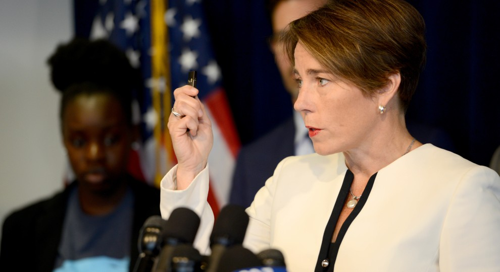Massachusetts Attorney General Maura Healey holds up an example of the popular e-cigarette