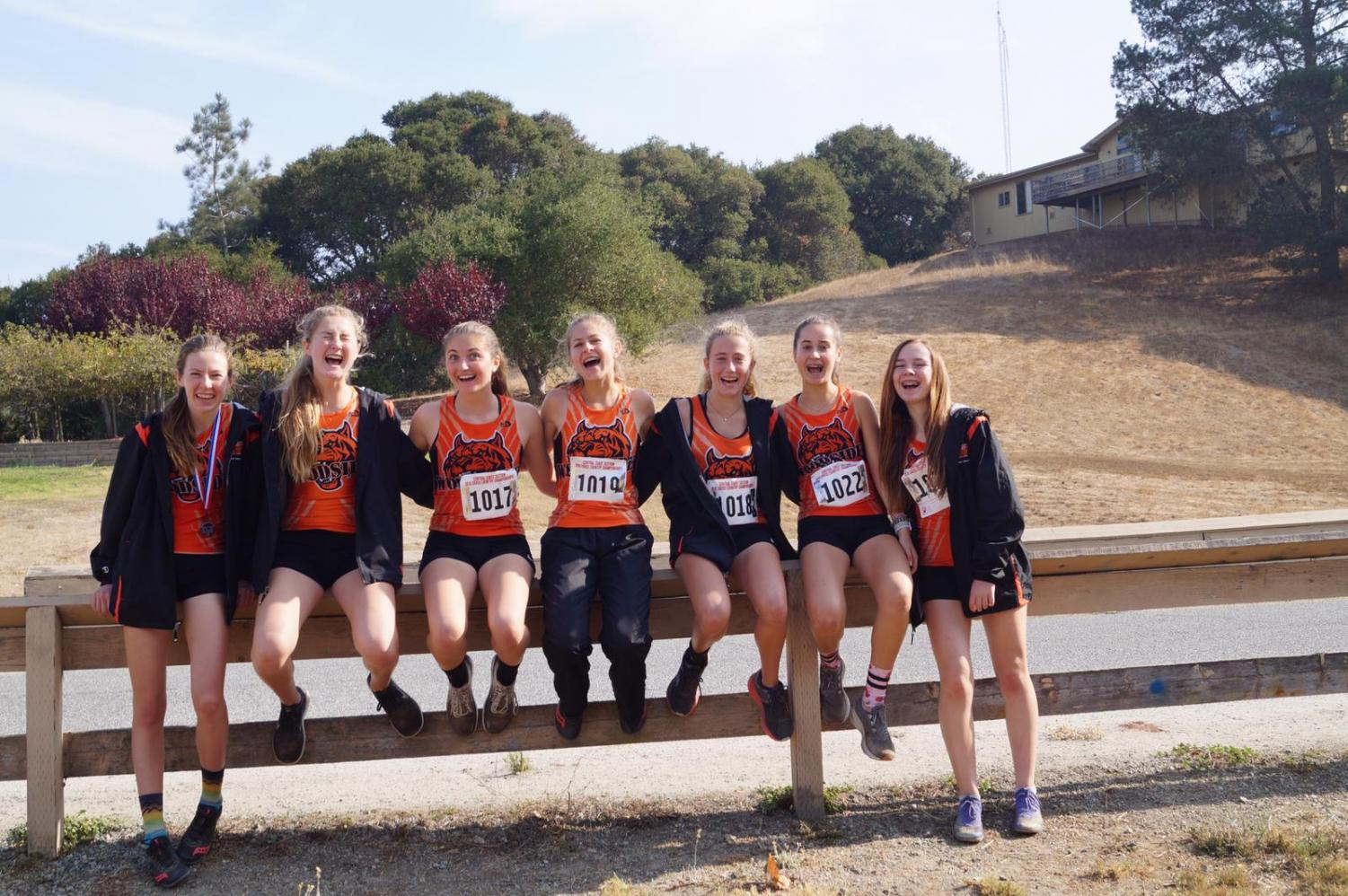 The varsity girls celebrate a great end to their season after running at Central Coast Sectionals Championship meet