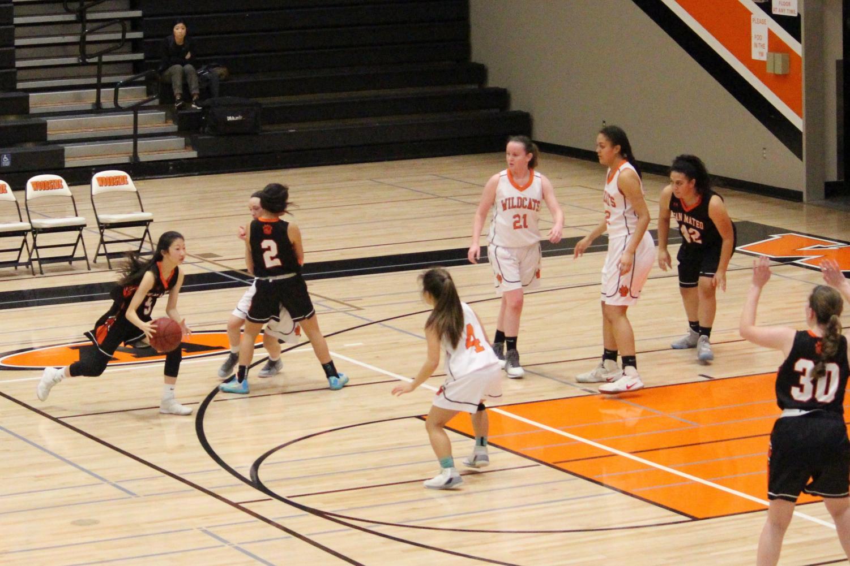 Woodside Girls Basketball playing against San Mateo last year