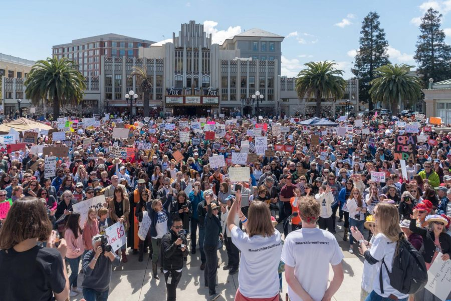 Student organizers stand in front of the March for Our Lives Redwood City crowd - Photo by Teri Vershel
