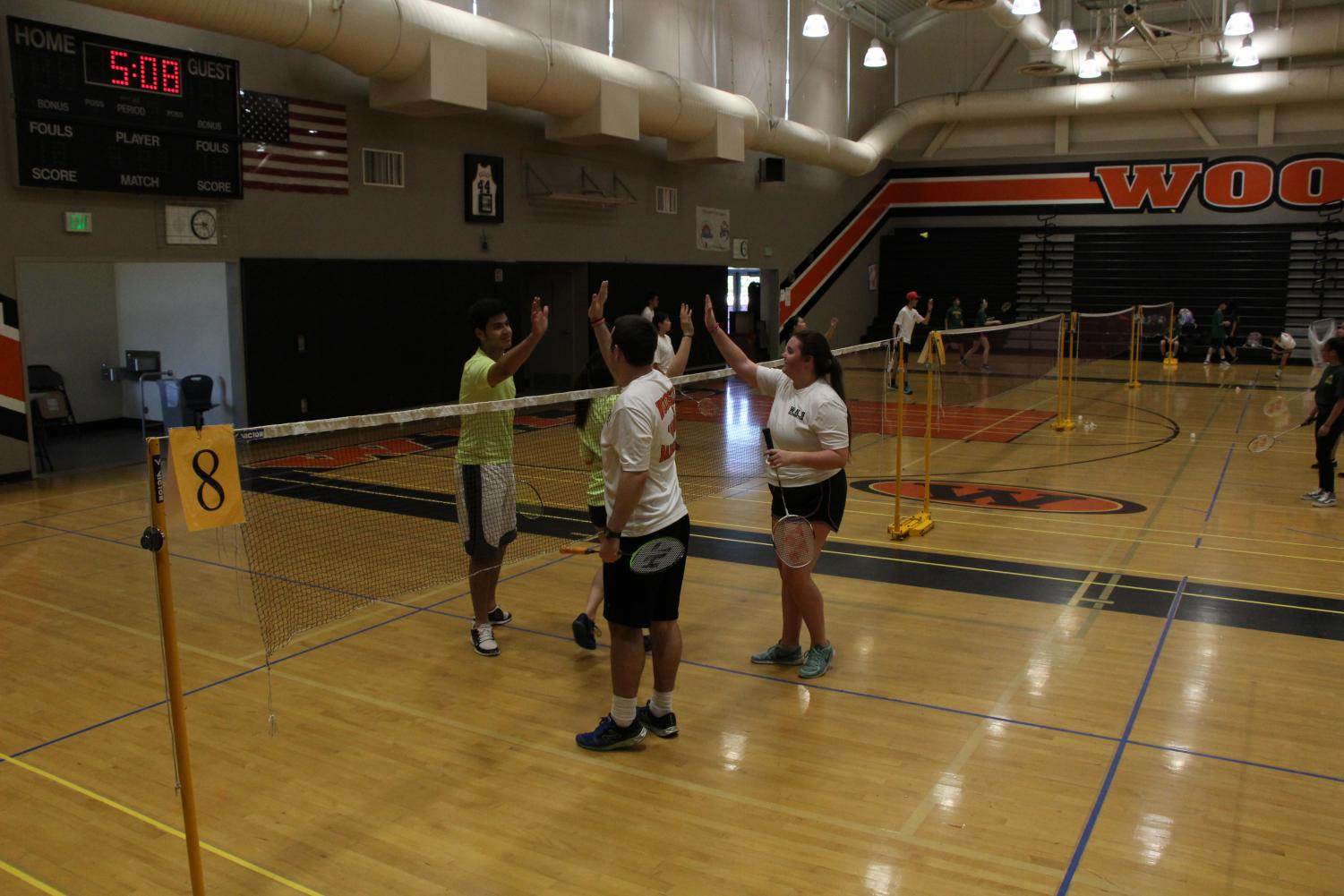 The Woodside badminton team shows their sportsmanship and support of each other.