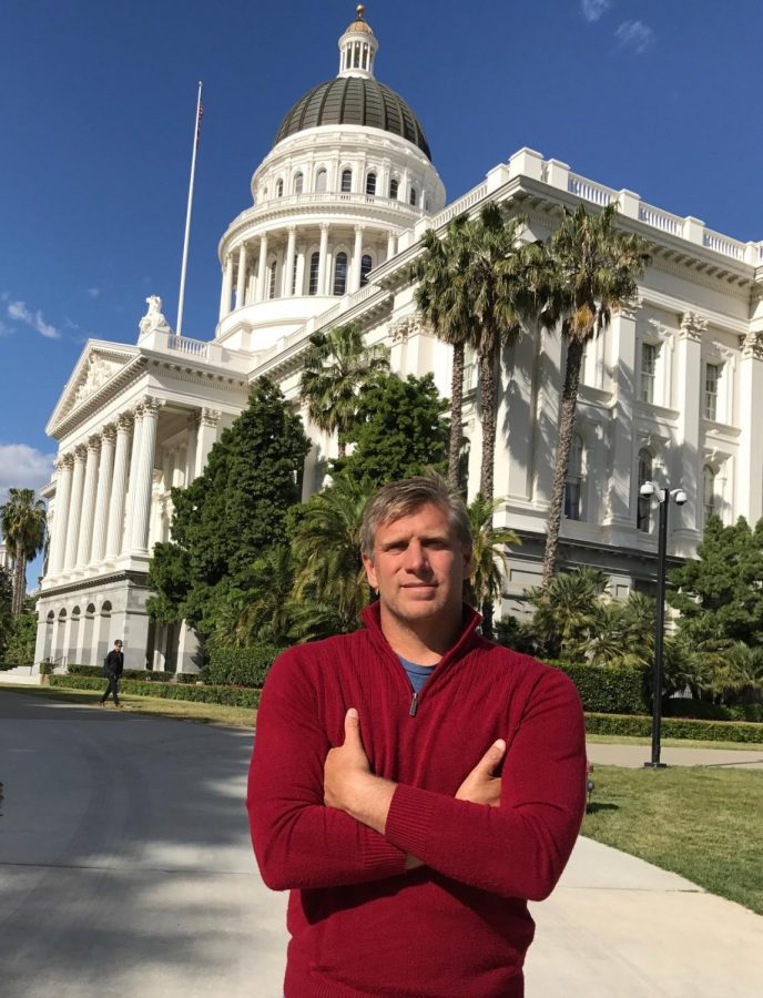 Gubernatorial candidate Zoltan Istvan stands outside California's Capitol Building.