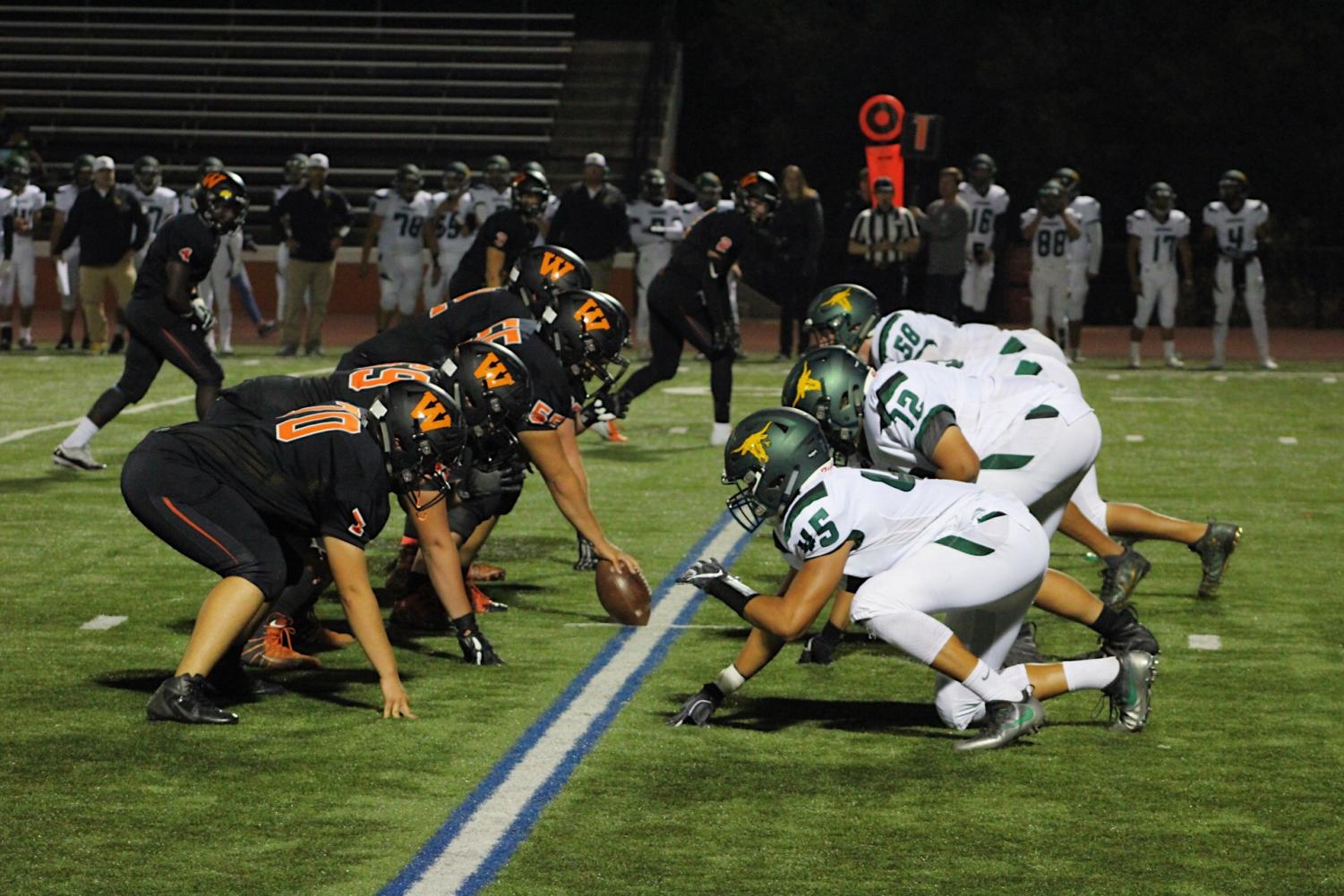 Woodside's line and Leigh's line face off before the snap.