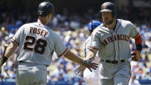 Buster Posey and Hunter Pence high five in their game against the LA Dodgers.