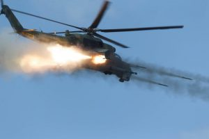 A Russian Mi-24 Gunship launches a spray of rockets during an air to ground exercise