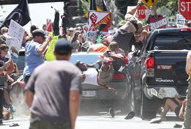 A car rams into a group of people protesting against the Unite the RIght rally in Charlottesville, Virginia. The driver was charged with second degree murder after his attack killed one person and injured 19 others.