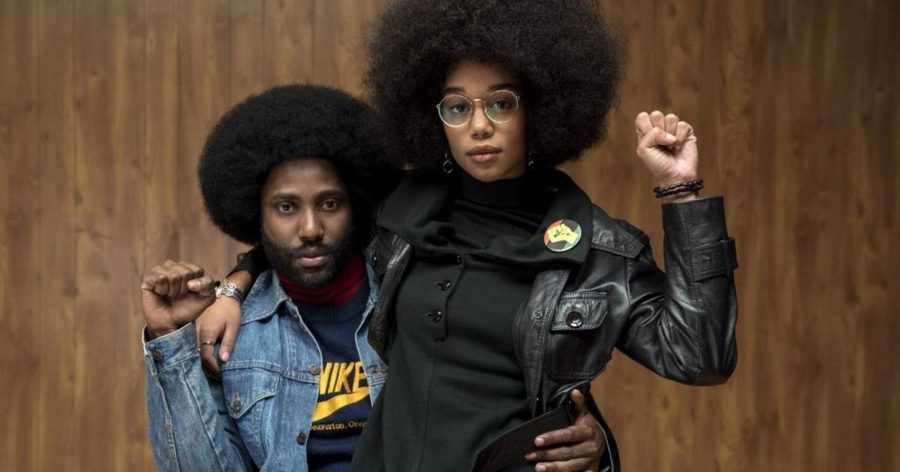 "Many black characters including Ron Stallworth (left) and Patrice (right) are seen with their hands in fists exclaiming, ""Power to all the people!"""
