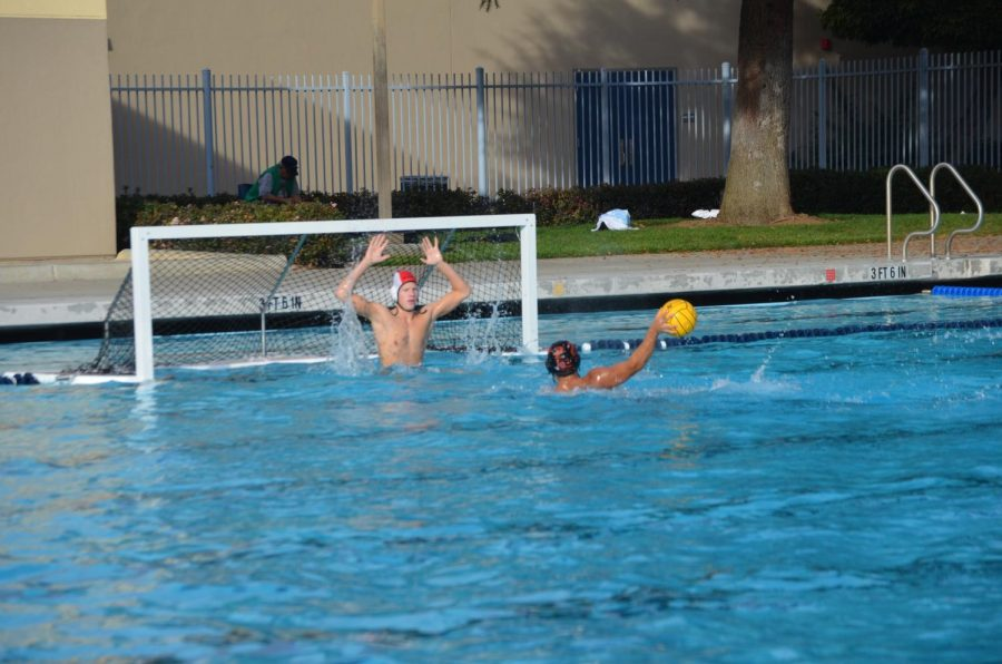 Woodside sophomore Kai Seed gets out of the water to block a penalty shot.