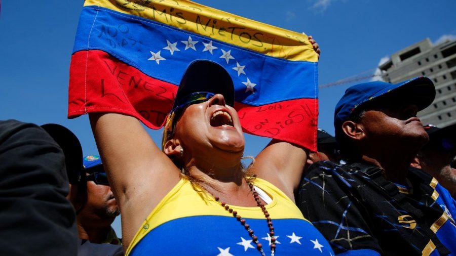 A+Venezuelan+citizen+participates+in+a+protest+against+the+government.