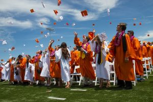 Woodside Grad Robes Go Orange