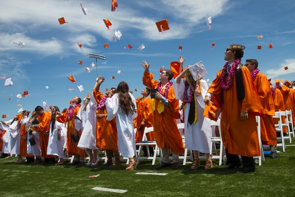 Traditionally, Woodside's female graduates wear white while male graduates wear orange.