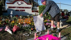 Adults and children gathered at Marjory Stoneman Douglas High School to mourn as a community.