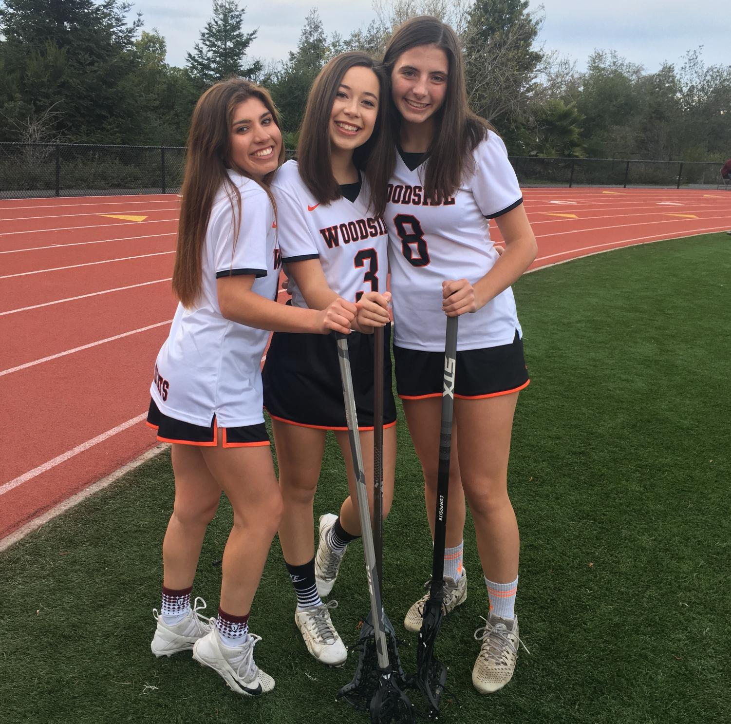 Three out of four of the varsity team captains of Woodside High girls lacrosse.