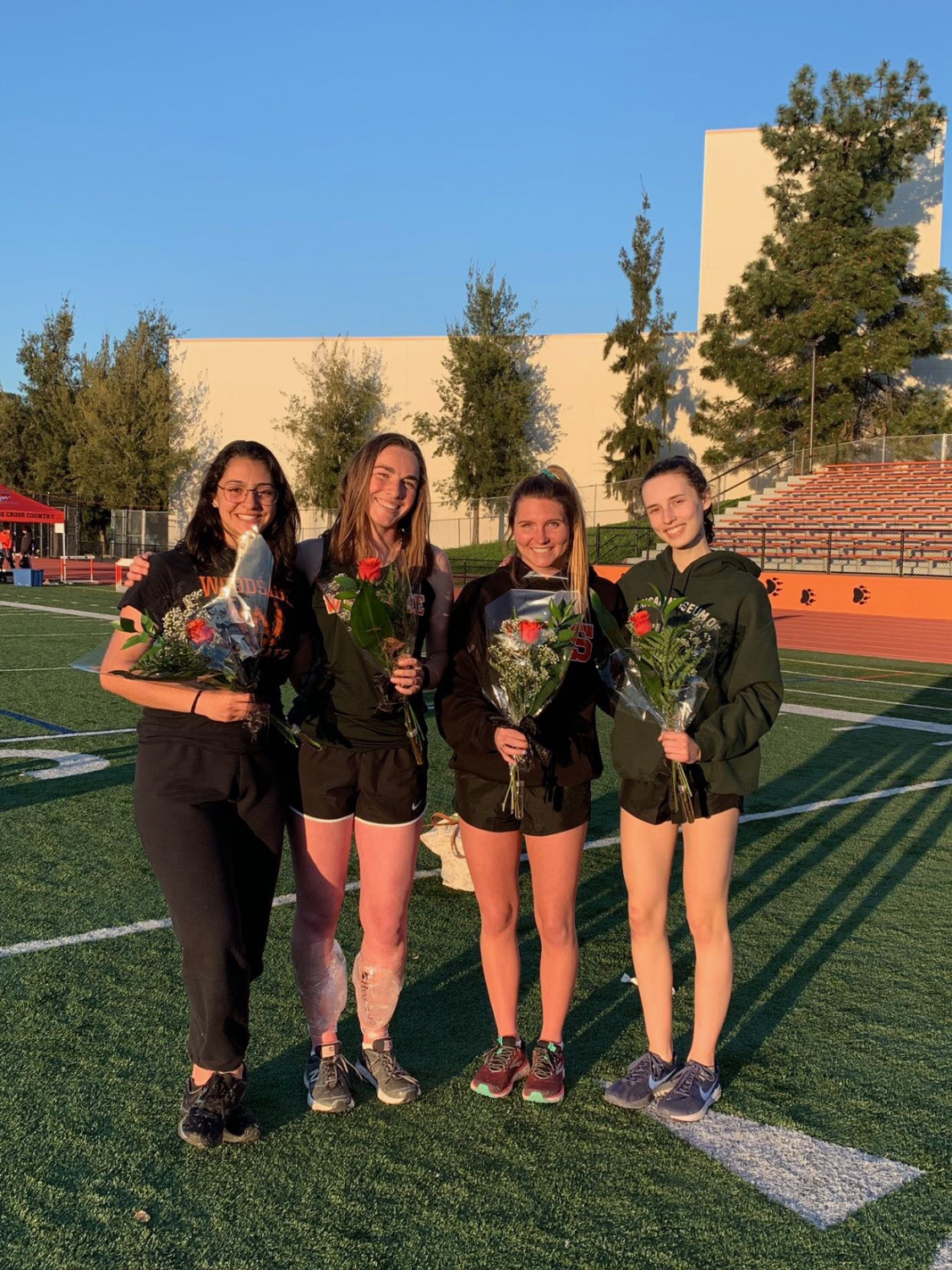 Seniors+are+celebrated+with+roses+at+their+last+home+meet+