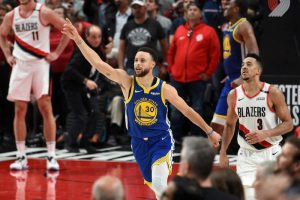 Stephen Curry celebrates an overtime victory in game four