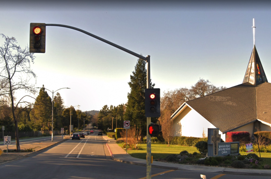 Alameda De Las Pulgas traffic lights while fully functioning.