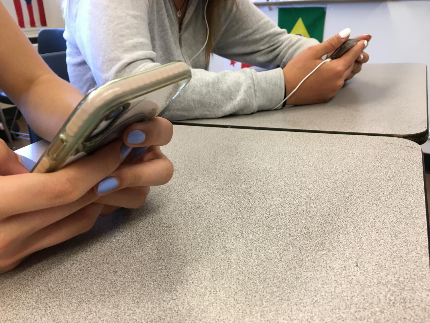 Students scroll on Instagram, a popular app among most Woodside students.