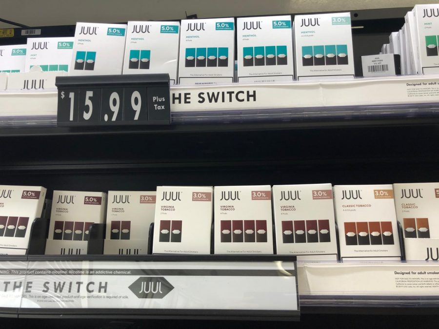 A variety of JUUL products for sale at a local gas station