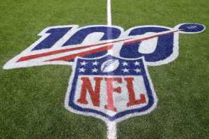 The NFL 100th season anniversary logo is displayed on the field.