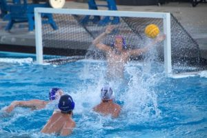 Woodside blocks their opposing team, Menlo-Atherton, from scoring a goal.