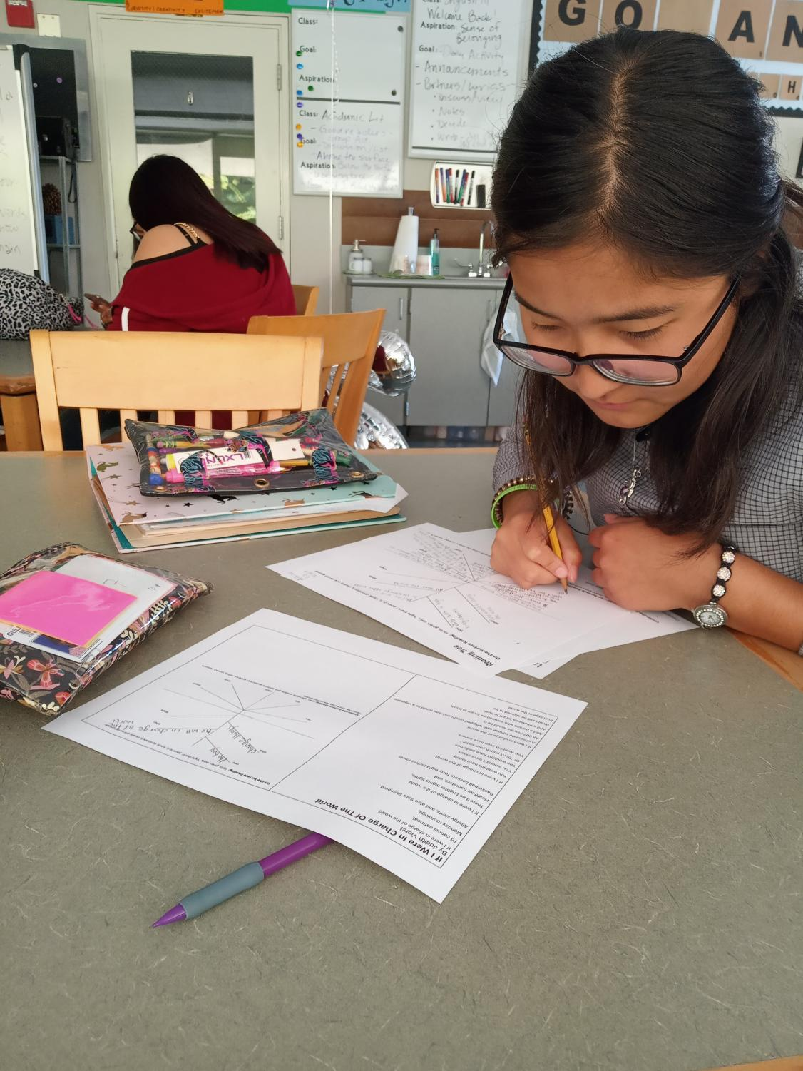 Woodside student Aibiike Abdysamatova works on her homework in the library after school.