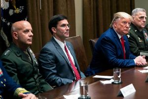 Mark Esper, second from left, and President Donald Trump, second from right, discuss the withdrawal from Northern Syria.