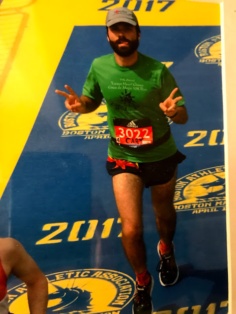 Woodside English teacher Cary Kelly runs the Boston Marathon in 2017. He has raced a total of 6 marathons, including