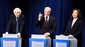 Larry David, Woody Harrelson, and Maya Rudolph (left to right) imitate candidates at the Democratic town hall.