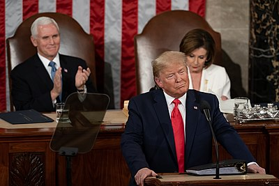 Trump delivers his State of the Union address while Vice President Mike Pence and House Speaker Nancy Pelosi listen behind him.
