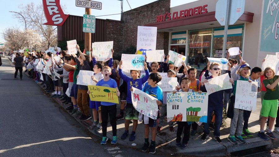 More+than+150+students+march+out+of+school%2C+holding+posters+and+chanting+%22save+our+Earth.%22