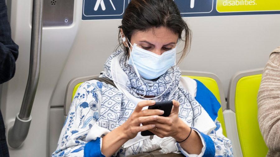 Here%2C+a+passenger+wears+a+face+mask+on+a+train+in+San+Francisco.