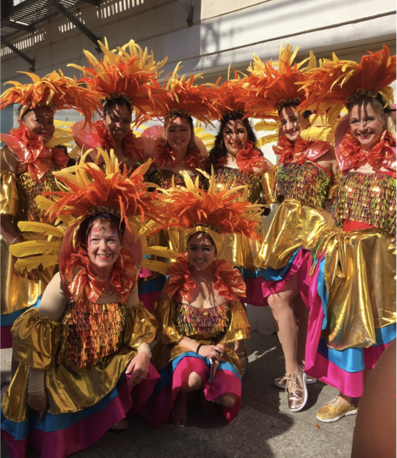 Ms. Ortez (fourth from the left) poses with her dance group.