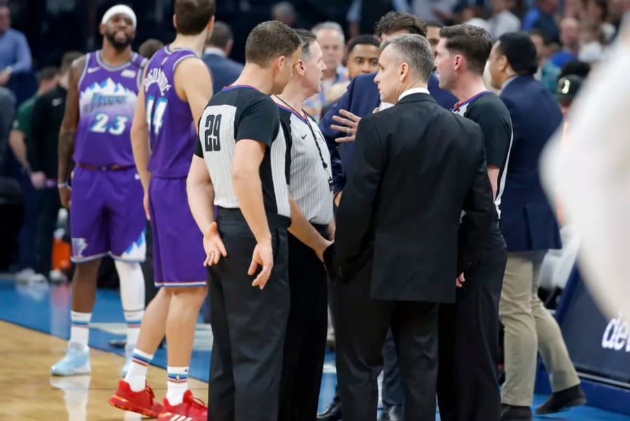 Oklahoma City coach Billy Donovan meets with officials before an NBA basketball game against the Utah Jazz was postponed.