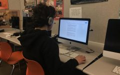 A student works on an online assignment to prepare for online learning.