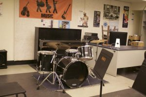 A drum set sits unattended in the Woodside jazz band room.