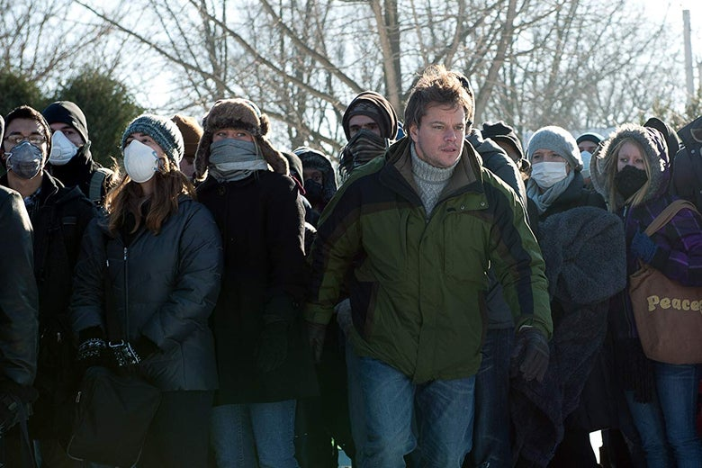 Mitch Emhoff (Matt Damon) stands in a crowd of masked civilians; the CDC now recommends wearing cloth coverings in public settings when social distancing cannot be maintained.