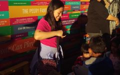 Grace Jau volunteers at an arts-and-crafts program for young children.