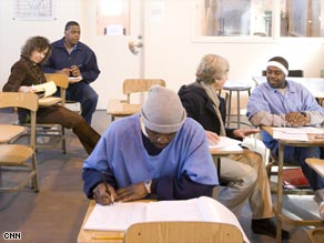 Inmates at the San Quentin State Prison working with tutors.