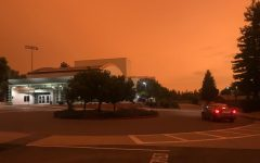 An orange, hazy cover of smoke is seen above the Woodside traffic circle and PAC on September 9th, 2020. The large amounts of smoke from the fire have been causing a variety of inconveniences for Woodside students and teachers since the fires were started less than a month earlier