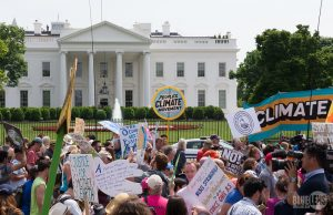 Climate justice protesters outside the White House at a protest in April 2017. Over three years later, climate change is more of an issue than ever.
