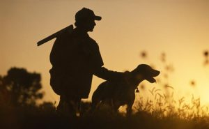 Man legally hunting with dog.