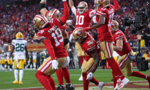 The forty-niner offense celbrates by spiking the ball on the ground after scoring a touchdown.