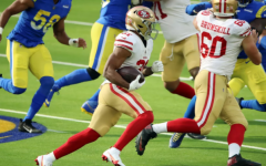 49er running back Raheem Mostert charges ahead  against the L.A. Rams, a divisional rival.