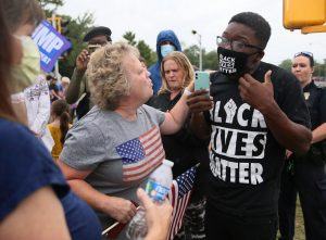Black Live Matter supporters and Trump supporters face off in Kenosha, Wisconsin.