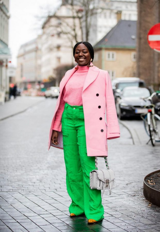 A woman wearing is standing wearing the color blocking trend.