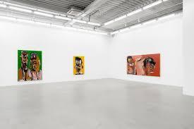 Showcase room featuring art from Genesis Tramain