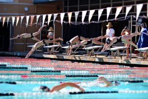 A mix of boy and girl swimmers made up Junior Varsity this year. Here they are making the dive into the pool.